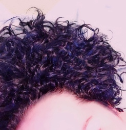 My natural curls after black dye started to turn to wavy hair